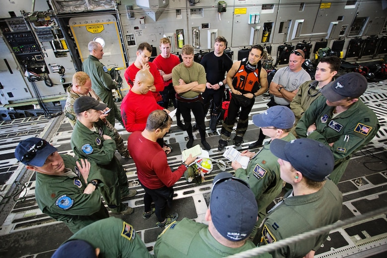 Members of the 920th Rescue Wing and the 249th Airlift Squadron conduct a pre-mission briefing aboard a C-17 Globemaster III aircraft at Patrick Air Force Base, Fla., Jan. 14 before departing for a simulated astronaut rescue mission. The 249th AS worked with NASA, the 920th Rescue Wing, the 45th Space Wing and Detachment 3 of the 45th Operations Group to develop tactics, training and procedures to quickly and safely recover astronauts in the event they would need to abort their spacecraft. (Courtesy photo by Senior Airman Zac Heinen)