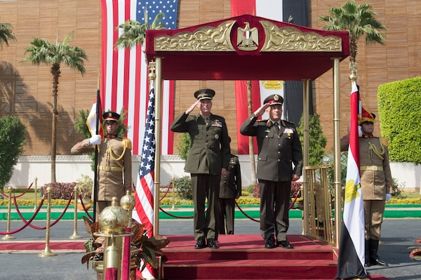 Marine Corps Gen. Joseph F. Dunford Jr., chairman of the Joint Chiefs of Staff, and Egyptian Chief of the Armed Forces Lt. Gen. Mahmoud Hegazy, right, render honors during an honor cordon at the Egyptian Ministry of Defense in Cairo, Feb. 20, 2016. DoD photo by D. Myles Cullen