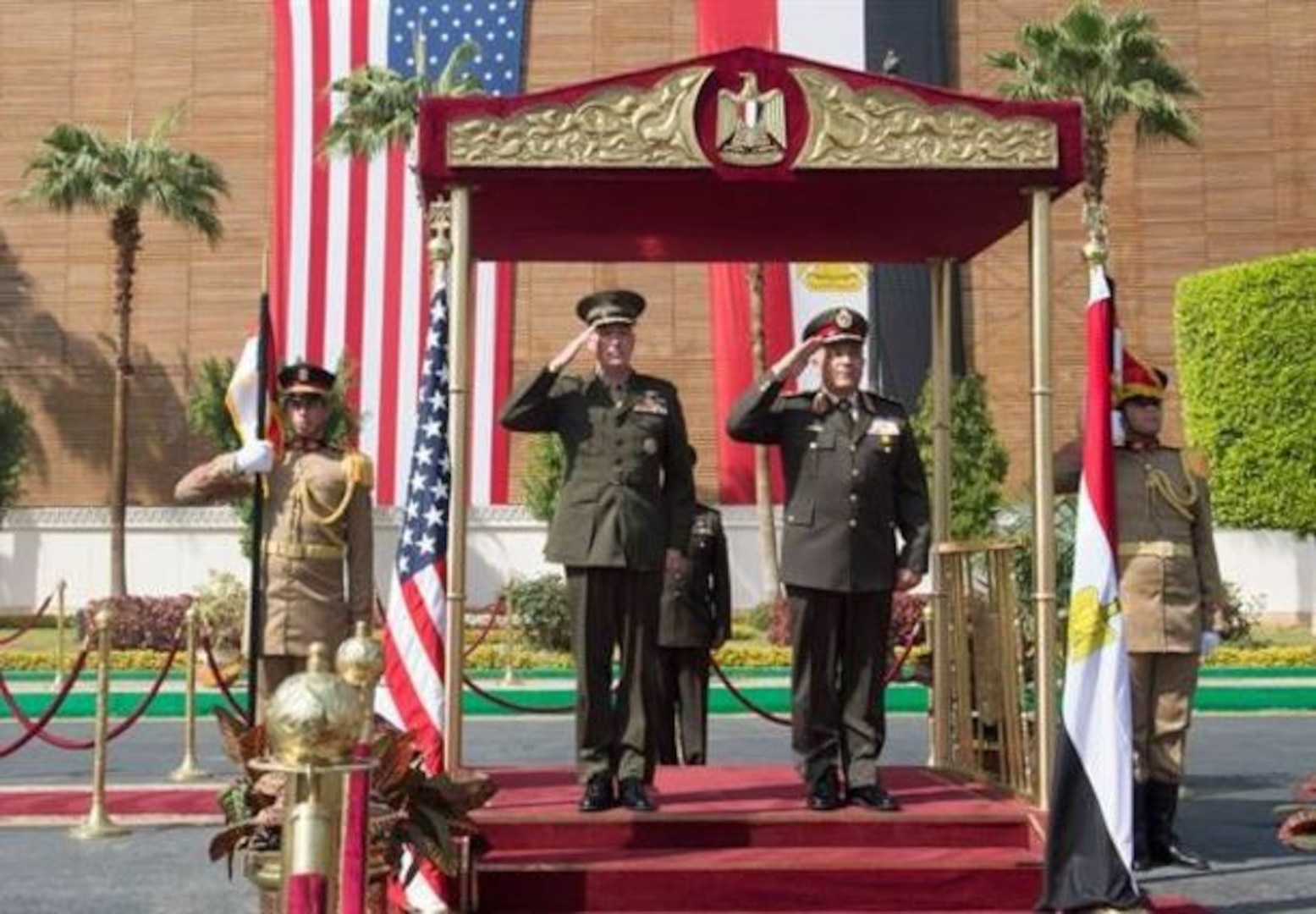 Marine Corps Gen. Joseph F. Dunford Jr., chairman of the Joint Chiefs of Staff, and Egyptian Chief of the Armed Forces Lt. Gen. Mahmoud Hegazy, right, render honors during an honor cordon at the Egyptian Ministry of Defense in Cairo, Feb. 20, 2016. (DoD photo by D. Myles Cullen)