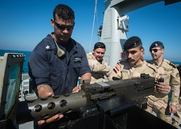 (Feb. 15, 2016) Gunner's Mate 1st Class Christopher Lamotte, assigned to the Arliegh Burke-class guided-missile destroyer USS Russell (DDG 59), dismounts a .50 cal to demonstrate how to properly perform maintenance to Iraqi Navy Sailors assigned to Iraqi Swift Boat (P-308) during a Iraqi bilateral exercise. The U.S. participates in bilateral exercises with partner nations in order to build and strengthen solid partnerships throughout the region. Commander, Task Force 55 controls surfaces including U.S. Navy coastal patrol craft and U.S. Coast Guard patrols boats in the U.S. 5th Fleet area of operations. U.S. 5th Fleet continues to expand its relationship with the Iraqi navy through key leader engagements, professional exchanges, and conduct exercises to ensure success as a capable force able to defend its territorial waters in the Arabian Gulf.
