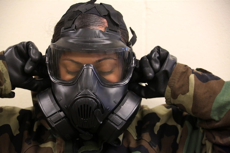 A Marine breaks the seal in her M50 Joint Service General Purpose Mask during gas chamber training at Marine Corps Air Station Cherry Point, N.C., Feb. 10, 2016. Marines with Marine Aviation Logistics Squadron 14 faced the CS gas as part of their qualification to familiarize themselves with the equipment and skills if faced with a biochemical attack. Marines of every military occupational specialty must be proficient with the equipment as it is part of every Marines' basic skills. (U.S. Marine Corps photo by Cpl. N.W. Huertas/Released)