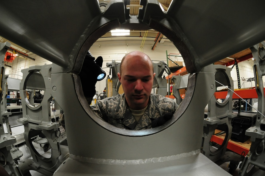 U.S. Air Force Senior Airman Nicholas McClary, a weapons specialist from the 509th Munitions Squadron, performs a serviceability check on an H1125A bomb handling truck at Whiteman Air Force Base, Mo., Feb. 12, 2016. Each component of the handling gear is inspected thoroughly to ensure it's operational before using it to install a weapon. (U.S. Air Force photo by Senior Airman Keenan Berry)