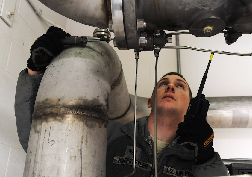 U.S. Air Force Staff Sgt. Daniel Huffstetler, the 509th Civil Engineer Squadron water and fuels systems maintenance supervisor, adjusts the rate of flow on a Type 5 fuel filter separator at Whiteman Air Force Base, Mo., Feb. 12, 2016. The Whiteman-specific Type 5 fueling system can distribute up to 4,800 gallons of fuel per minute to multiple B-2 Spirits at any given time. (U.S. Air Force photo by Airman 1st Class Michaela R. Slanchik)