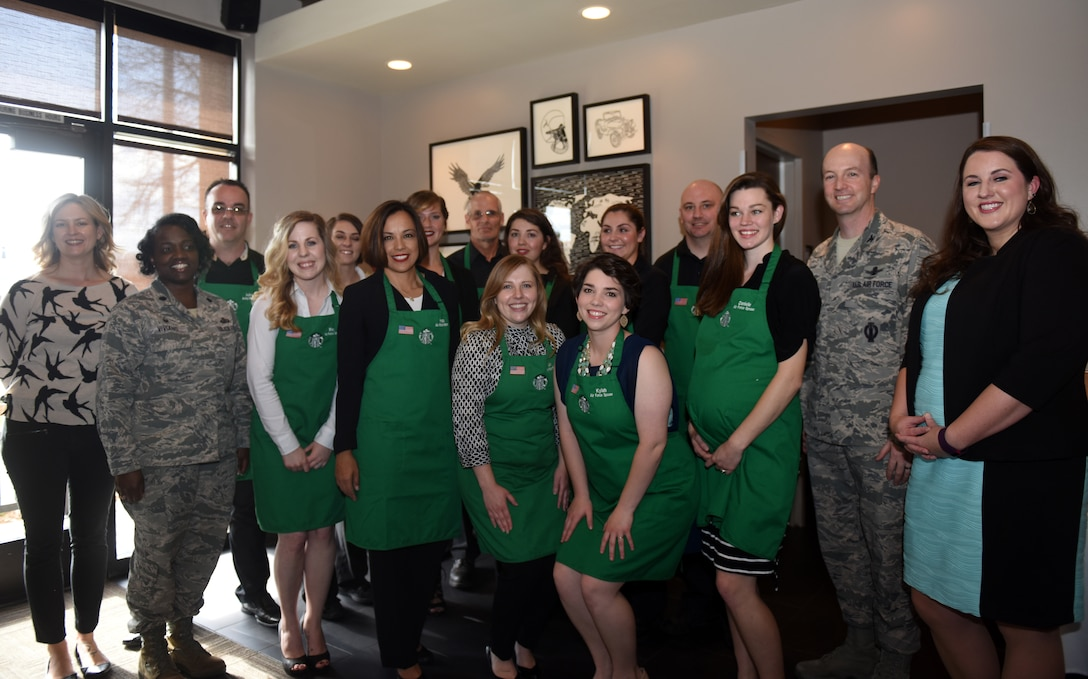 Leadership from Vandenberg Air Force Base and military spouses and veterans employed at Starbucks, pose for a group photo during a Military Family Store dedication, Feb. 18, 2016, at Starbucks in Lompoc, Calif. Because of the successful partnership between Vandenberg AFB and Starbucks, and the hiring efforts on a local level, the Lompoc Starbucks was recently dedicated as a Military Family Store. (U.S. Air Force photo by Senior Airman Kyla Gifford/Released)