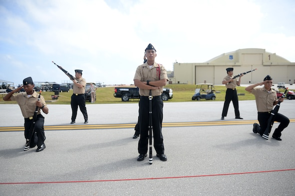 Drill members with the Guam High School Junior Reserve Officer Training Corps finish their routine Feb. 20 during the 2016 Pacific Air Partners Open House at Andersen Air Force Base, Guam.  In addition to their presentation, drill teams from Okkodo High School and John F. Kennedy High School performed for the crowd during the open house. (U.S. Air Force photo/Senior Airman Joshua Smoot)