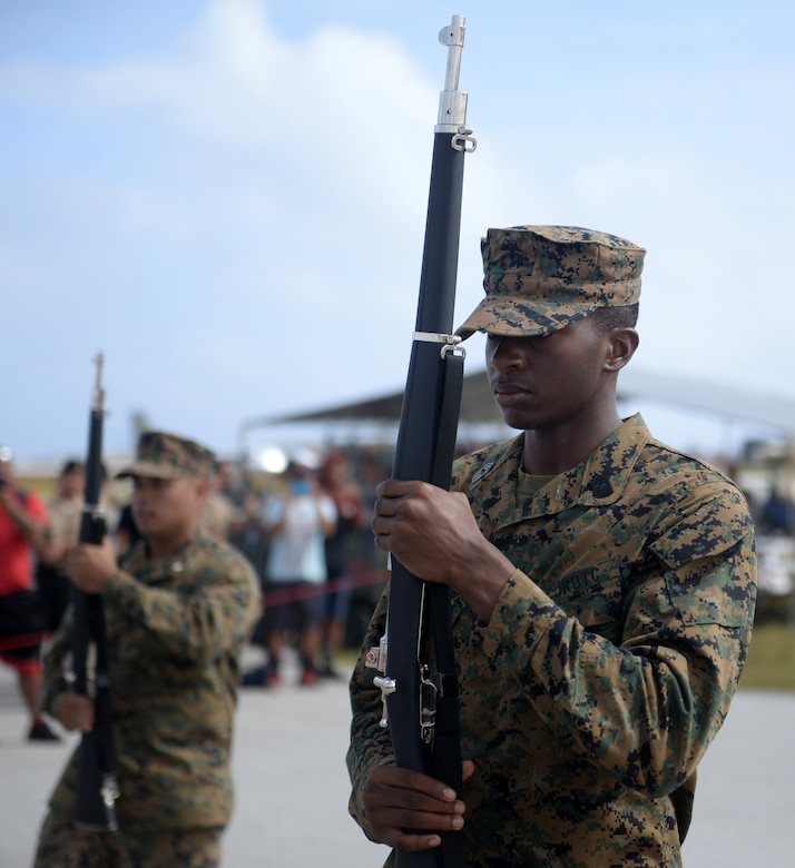A drill member with the Okkodo High School Junior Reserve Officer Training Corps holds a rifle for a routine Feb. 20 during the 2016 Pacific Air Partners Open House at Andersen Air Force Base, Guam.  In addition to their presentation, drill teams from Guam High School and John F. Kennedy High School performed for the crowd during the open house. (U.S. Air Force photo/Senior Airman Joshua Smoot)
