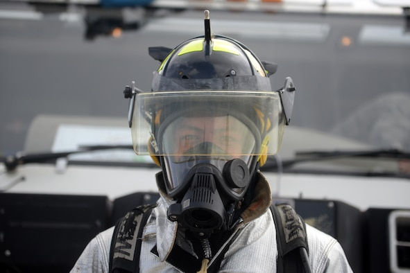 Airman 1st Class Niko Diego, 36th Civil Engineer Squadron firefighter, stands for a photo Feb. 20 during a fire truck demonstration at the 2016 Pacific Air Partners Open House at Andersen Air Force Base, Guam. Diego, alongside other members of the fire department, provided attendees the opportunity to sit in a fire truck and learn about their mission. (U.S. Air Force photo/Senior Airman Joshua Smoot)