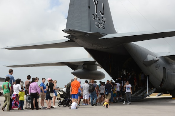 Crowds of people line up to see a C-130 Hercules Feb. 20 during the 2016 Pacific Air Partners Open House at Andersen Air Force Base, Guam. The event included multiple aircraft static displays, flyovers, ground demonstrations and live bands.(U.S. Air Force photo/Airman 1st Class Arielle Vasquez)