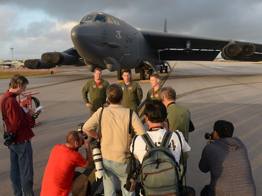 B-52 Stratofortress aviators are interviewed by local and international media members Feb. 20 before the start of the 2016 Pacific Air Partners Open House at Andersen Air Force Base, Guam. The aviators met with media members to talk about the mission of Andersen AFB, their support of EXERCISE COPE NORTH and the continuous bomber presence. (U.S. Air Force photo/Staff Sgt. Benjamin Gonsier)