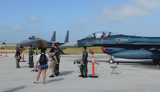 Japan Air Self-Defense Force Airmen interact with visitors of the 2016 Pacific Air Partners Open House Feb. 20 at Andersen Air Force Base, Guam. At the open house, the JASDF had multiple aircraft out on display to include the F-15J Eagle and F-2 Viper Zero. The JASDF and Royal Australian Air Force joined the U.S. Air Force in demonstrating pacific airpower to the attendees of the open house. (U.S. Air Force photo/Staff Sgt. Benjamin Gonsier)