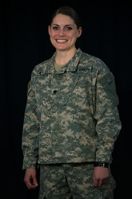 Spc. Amy Carle, a member of the California Army National Guard, displays her positive attitude during a Feb. 17, 2016, photo shoot before graduating from the Basic Public Affairs Specialist Course at the Defense Information School on Fort Meade, Md., Carle completed the 56-day course, which covers journalism, photojournalism and public affairs, on Feb. 19 as the distinguished honor graduate.
