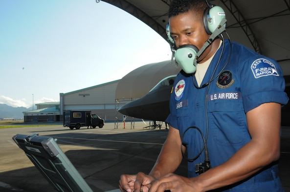 Senior Airman Jermaine James a crew chief with the 477th Maintenance Squadron based out of Alaska completes final checks prior to launching a Hawaii Air National Guard F-22 Raptor at Joint Base Pearl Harbor-Hickam, Feb. 5, 2016. While on temporary duty in Hawaii, the 477th MXS assisted 154th MXS counterparts with the maintenance of the Hawaiian Raptors. (U.S. Air National Guard photo by Senior Airman Orlando Corpuz/released)