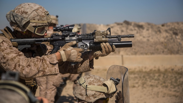 U.S. Marine Corps Lance Cpl. Tanner Walker with Charlie Company, 1st Battalion, 7th Marine Regiment, attached to Special Purpose Marine Air-Ground Task Force-Crisis Response-Central Command, fires an M203 grenade launcher as part of non-lethal weapons training at an undisclosed location in Southwest Asia, Feb. 2, 2016. SPMAGTF-CR-CC Marines hone their skills in the event of non-lethal combatant operations.