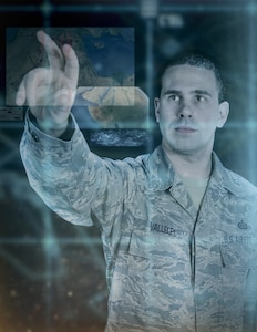 Graphic representation of Tech. Sgt. Jason Valleley, 204th intelligence analyst, as he simulates manipulating data in Google Earth. Valleley headed the development for a way to use classified Google Earth with integrated intelligence gathered from multiple sources to aid United States' military units throughout the world. The images employed in this illustration are purely representational and do not reflect any current or past intelligence operations.