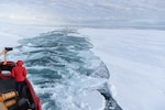 The Coast Guard Cutter Polar Star cuts a channel into a field of fast ice in McMurdo Sound, Antarctica, Jan. 7, 2016. During Operation Deep Freeze 2016, the U.S. military's logistical support to the National Science Foundation-managed U.S. Antarctic Program, the Polar Star's mission is to create a navigable channel to McMurdo Station for several resupply vessels.