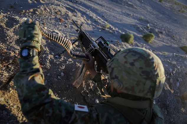 A machine gunner assigned to the Western Army Infantry Regiment, Japan Ground Self Defense Force, reloads a M249 squad automatic weapon during Exercise Iron Fist 2016, aboard Marine Corps Air Ground Combat Center Twentynine Palms, Calif., Feb. 9, 2016. Iron Fist is an annual, bi-lateral training exercise between the Japan Ground Self Defense Force and Marines to strengthen warfighting capabilities in ship to shore operations.