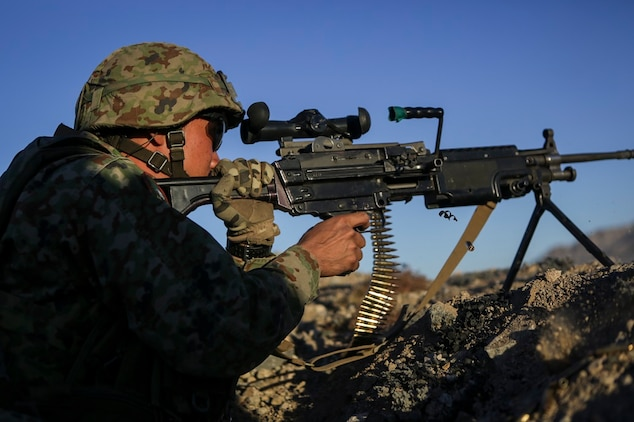 A machine gunner assigned to the Western Army Infantry Regiment, Japan Ground Self Defense Force, fires a M249 squad automatic weapon during Exercise Iron Fist 2016, aboard Marine Corps Air Ground Combat Center Twentynine Palms, Calif., Feb. 9, 2016. Iron Fist is an annual, bi-lateral training exercise between the Japan Ground Self Defense Force and Marines to strengthen warfighting capabilities in ship to shore operations.