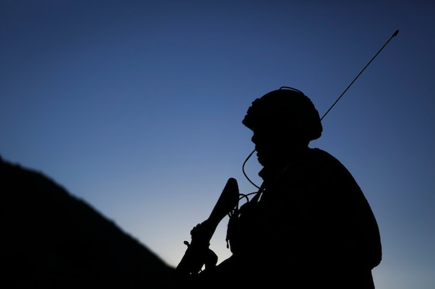 A field radio operator assigned to Western Army Infantry Regiment, Japan Ground Self Defense Force, observes the impact area, during a live-fire platoon level assault, during Exercise Iron Fist 2016, aboard Marine Corps Air Ground Combat Center Twentynine Palms, Feb. 9, 2016. Iron Fist is an annual, bi-lateral training exercise between the Japan Ground Self Defense Force and Marines to strengthen warfighting capabilities in ship to shore operations.