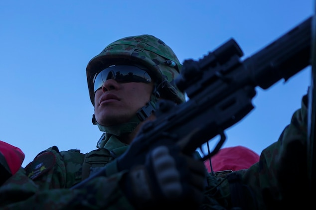 A rifleman assigned to Western Army Infantry Regiment, Japan Ground Self Defense Force, provides security from an amphibious assault vehicle, during a live-fire platoon level assault, during Exercise Iron Fist 2016 aboard Marine Corps Air Ground Combat Center Twentynine Palms, Feb. 9, 2016. Iron Fist is an annual bilateral training exercise between the Japan Ground Self Defense Force and Marines to strengthen warfighting capabilities in ship to shore operations.