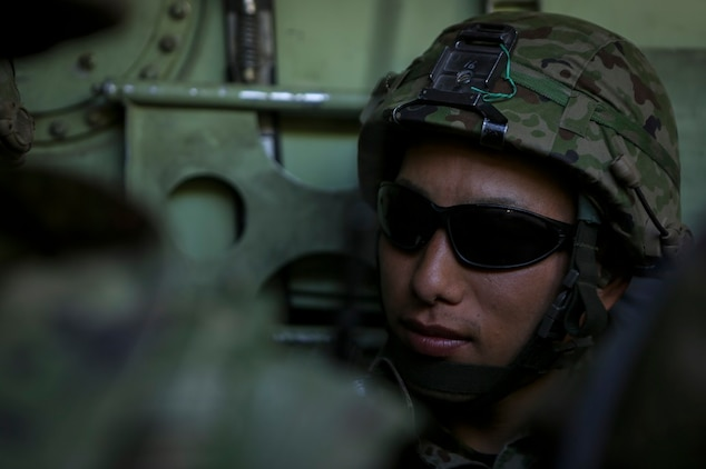 Sergeant Hatsumura Shoutarou, a rifleman with 3rd Company, Western Army Infantry Regiment, Japan Ground Self Defense Force, prepares to dismount an amphibious assault vehicle to conduct a live-fire platoon level assault during Exercise Iron Fist 2016, aboard Marine Corps Air Ground Combat Center Twentynine Palms, Feb. 9, 2016. Iron Fist is an annual, bi-lateral training exercise between the Japan Ground Self Defense Force and Marines to strengthen warfighting capabilities in ship to shore operations.