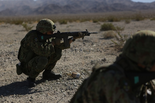 A rifleman assigned to the Western Army Infantry Regiment, Japan Ground Self Defense Force, fires on simulated targets, during a live-fire platoon level assault during Exercise Iron Fist 2016 aboard Marine Corps Air Ground Combat Center Twentynine Palms, Feb. 9, 2016. Iron Fist is an annual, bi-lateral training exercise between the Japan Ground Self Defense Force and Marines to strengthen warfighting capabilities in ship to shore operations.