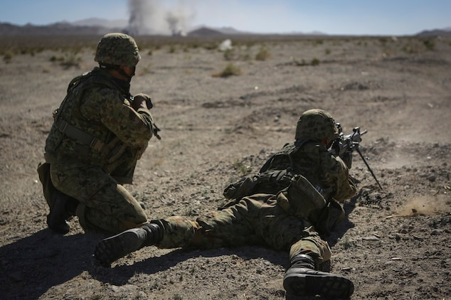 A machine gunner assigned to the Western Army Infantry Regiment, Japan Ground Self Defense Force, fires on simulated targets, during a live-fire platoon level assault during Exercise Iron Fist 2016 aboard Marine Corps Air Ground Combat Center Twentynine Palms, Feb 9, 2016. Iron Fist is an annual bilateral training exercise between the Japan Ground Self Defense Force and Marines to strengthen warfighting capabilities in ship to shore operations.