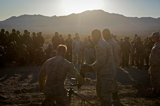 Marines assigned to Weapons Company, 1st Battalion, 4th Marine Regiment, 1st Marine Division, demonstrate the misfire procedures for an 81 mm mortar system during Exercise Iron Fist 2016 aboard Marine Corps Air Ground Combat Center Twentynine Palms, Calif., Feb. 9, 2016. Iron Fist is an annual, bi-lateral training exercise between the Japan Ground Self Defense Force and Marines to strengthen warfighting capabilities from ship to shore.