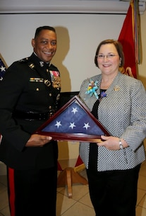 Major General Craig C. Crenshaw, Commanding General, LOGCOM, retires Mrs. Donna Harris, Director, Organizational Development Office, LOGCOM, during a ceremony held on 17 February 2016. Mrs. Harris had over 27 years of honorable service. Congratulations Mrs. Harris...you will be missed.