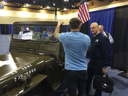 Defense Logistics Agency Aviation Commander Air Force Brig. Gen. Allan Day tours additive manufacturing displays Dec. 2, 2015 during the Defense Manufacturing Conference in Phoenix, Arizona.