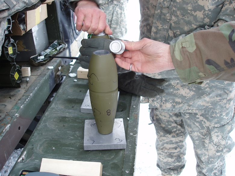 Insensitive Munitions tests by the Cold Regions Research and Engineering Laboratory (CRREL)use fuze simulators on live rounds to initiate the detonations.