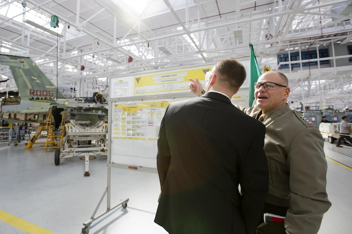 Commandant of the Marine Corps (CMC) Gen. Robert B. Neller, right, makes remarks to Col. Scott F. Benedict, the military secretary for the CMC, during his visit to the Fleet Readiness Center Southwest (FRCSW) at Naval Air Station North Island, Calif., Feb. 19, 2016. Neller toured the depot to observe the FA-18 maintenance repair process. (U.S. Marine Corps photo by Staff Sgt. Gabriela Garcia/Released)