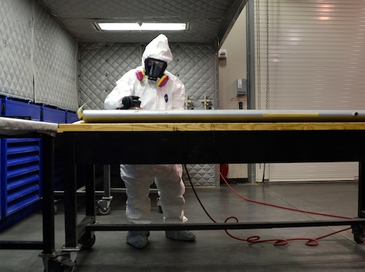 Senior Airman Joshua, a 432nd Maintenance Squadron aircraft structural maintenance journeyman, sands down a wing panel for the MQ-1 Predator Feb. 18, 2016, at Creech Air Force Base, Nev. The Predator and MQ-9 Reaper are made completely of composite materials such as carbon fiber, Kevlar and specialized variations of fiberglass. Structural maintenance Airmen must wear proper protective equipment to keep the hazardous carbon shavings and paint from being inhaled. (U.S. Air Force photo/Senior Airman Christian Clausen)