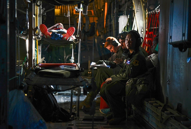 Capt. Melissa Cadorette, a flight nurse with the 18th Aeromedical Evacuation Squadron, listens to crew communications aboard a U.S. Air Force C-130 Hercules Feb. 15, 2016, during an expeditionary medical support exercise on the island of Rota. Exercise Cope North 16 enhances humanitarian assistance and disaster relief crisis response capabilities between six nations and lays the foundation for regional cooperation during real-world contingencies in the Indo-Asia-Pacific region. (U.S. Air Force photo by Staff Sgt. Alexander W. Riedel/Released)
