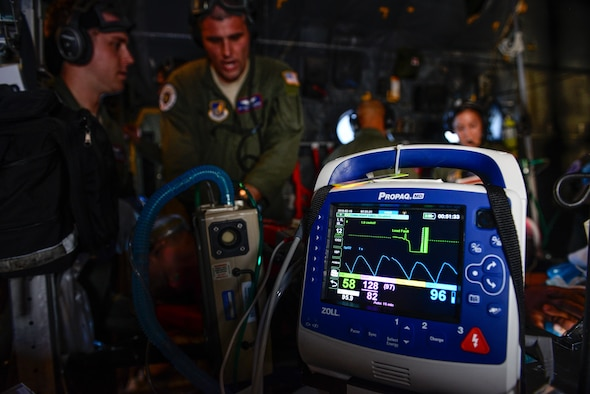Staff Sgt. Matthew Flowers, an aeromedical evacuation technician with the 18th Aeromedical Evacuation Squadron, performs simulated CPR aboard a C-130 Hercules Feb. 15, 2016, during an expeditionary medical support exercise above the Pacific Ocean near Guam. Exercise Cope North 16 enhances humanitarian assistance and disaster relief crisis response capabilities between six nations and lays the foundation for regional cooperation during real-world contingencies in the Indo-Asia-Pacific region. (U.S. Air Force photo/Staff Sgt. Alexander W. Riedel)
