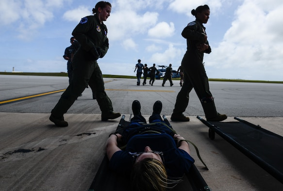 A patient with simulated injuries lies waiting while U.S. Air Force and Japan Air Self-Defense Force aeromedical evacuation crews prepare for a patient transfer Feb. 17, 2016, at Andersen Air Force Base, Guam. Exercise Cope North 16 enhances humanitarian assistance and disaster relief crisis response capabilities between six nations and lays the foundation for regional cooperation expansion during real-world contingencies in the Indo-Asia-Pacific Region. (U.S. Air Force photo by Staff Sgt. Alexander W. Riedel/Released)