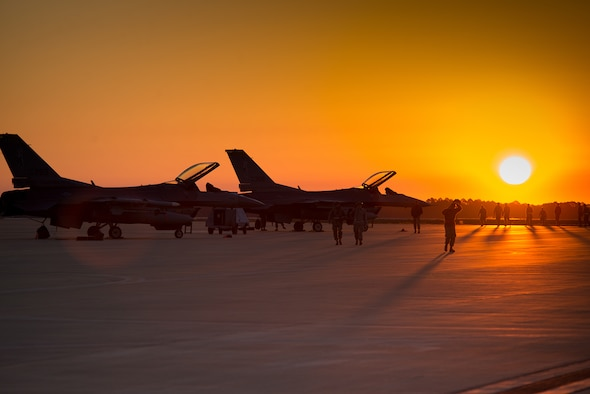 Airmen with the 158th Fighter Wing Maintenance Squadron conduct an early morning foreign object debris walk before daily operations on the flight line at Eglin Air Force Base, Fla., Feb. 8, 2016. The Green Mountain Boys participated in operation Combat Hammer, a Weapon System Evaluation Program. The WSEP evaluates the effectiveness of precision guided munitions when employed in air-to-ground combat. (U.S. Air Force photo by Airman 1st Class Jeffrey Tatro)