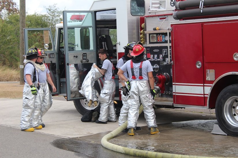 SOTO CANO AIR BASE, Honduras - Firefighters with the 612th Air Base Squadron, conduct an equipment check before entering a simulated structural fire during a monthly familiarization and proficiency exercise, Feb. 18, 2016, at Soto Cano Air Base, Honduras. The firefighters take part in these exercises on a regular basis to maintain their ability to respond to different emergency situations and keep their knowledge and response procedures up-to-date. (U.S. Army photo by Maria Pinel)