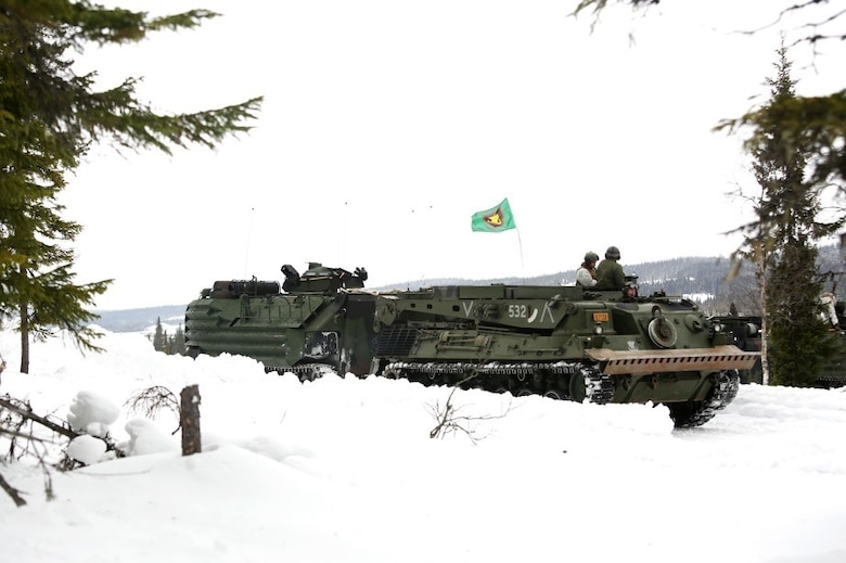 A Norwegian recovery vehicle hooks up to a U.S. Marine Corps Amphibious Assault Vehicle prior to the start of a live-fire range in Rena, Norway, as part of their pre-exercise training Feb. 17,2016. The Marines and Norwegian Army are working together as part of Exercise Cold Response, a joint NATO and allied country exercise comprised of 12 countries and approximately 16,000 troops. The U.S. European Command appreciates the opportunity for taking part in such a large multinational exercise at the invitation of our Norwegian Allies; and we are especially thankful for the chance to put our skills to the test in unique cold weather conditions. (U.S. Marine Corps photo by Master Sgt. Chad McMeen/Released)