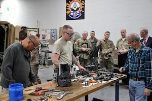 Maj. Gen. Flem B. Walker, Jr., the Deputy Chief of Staff, Logistics (G-4) for U.S. Army Forces Command, observes students training at the Sustainment Training Center, located in Johnston, Iowa. Walker toured the Iowa National Guard facility during a recent visit to Camp Dodge.