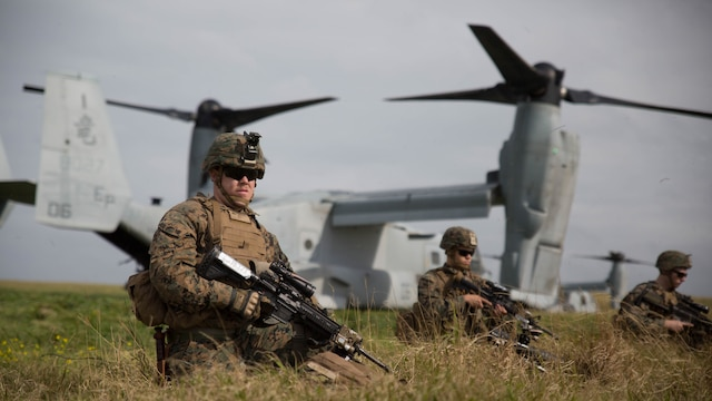 Marines with Charlie Company, Battalion Landing Team 1st Battalion, 5th Marines, 31st Marine Expeditionary Unit, secure their perimeter after disembarking from MV-22B Ospreys at Ie Shima Training Facility, Okinawa, Japan, Feb. 12, 2016. Marines and sailors with the 31st MEU flew from the USS Bonhomme Richard to Ie Shima for a vertical assault as part of amphibious integration training with the Navy ships of the Bonhomme Richard Amphibious Ready Group. The 31st MEU is currently deployed to the Asia-Pacific region.