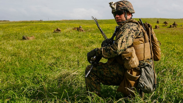 Capt. Christopher Caldwell, the company commander with Charlie Company, Battalion Landing Team 1st Battalion, 5th Marines, 31st Marine Expeditionary Unit, scans his Marines' positions as they prepare for an assault on the airfield at Ie Shima Training Facility, Okinawa, Japan, Feb. 12, 2016. Marines and sailors with the 31st MEU flew from the USS Bonhomme Richard to Ie Shima for a vertical assault as part of amphibious integration training with the Navy ships of the Bonhomme Richard Amphibious Ready Group. The 31st MEU is currently deployed to the Asia-Pacific region. Caldwell is a native of Virginia Beach, Virginia.