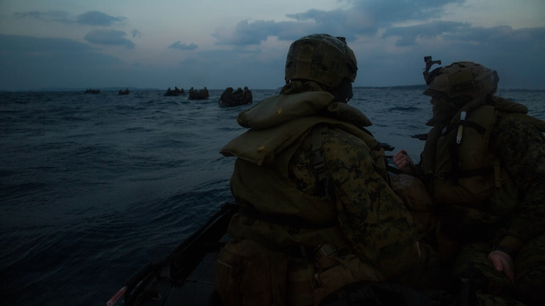 Marines with Bravo Company, Battalion Landing Team 1st Battalion, 5th Marines, 31st Marine Expeditionary Unit, line up behind other Combat Rubber Raiding Craft after launching from the USS Germantown for a boat raid, Feb. 16 , 2016. The Marines conducted the boat raid as part of the 31st MEU's amphibious integration training with the Navy ships of the Bonhomme Richard Amphibious Ready Group. The Marines and sailors of the 31st MEU are currently deployed to the Asia-Pacific region.