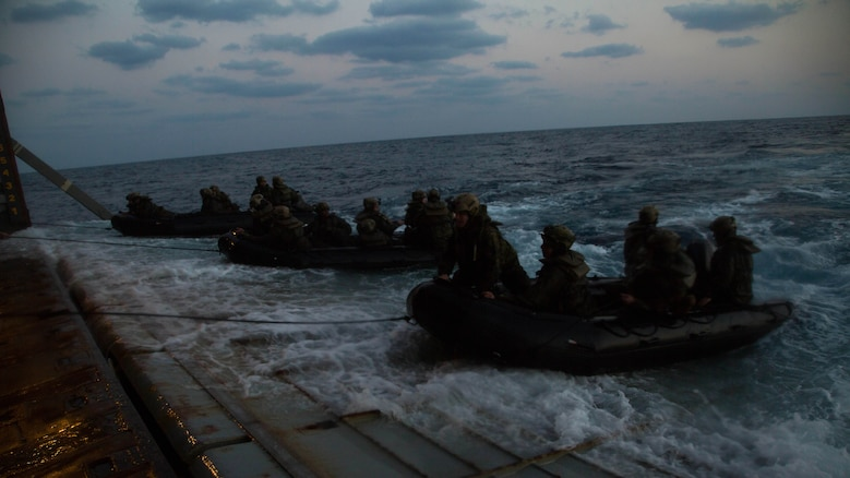 Marines with Bravo Company, Battalion Landing Team 1st Battalion, 5th Marines, 31st Marine Expeditionary Unit, drive Combat Rubber Raiding Craft into the well deck of the USS Germantown, Feb. 17 , 2016, after conducting a successful boat raid the night before. The Marines conducted the boat raid as part of the 31st MEU's amphibious integration training with the Navy ships of the Bonhomme Richard Amphibious Ready Group. The Marines and sailors of the 31st MEU are currently deployed to the Asia-Pacific region.
