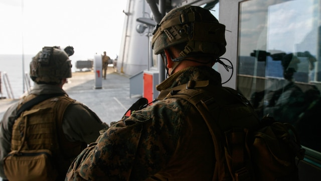 Two reconnaissance Marines with Maritime Raid Force, 31st Marine Expeditionary Unit, work to secure the upper decks of the USNS Rappahannock during a visit, board, search and seizure training exercise Feb. 17, 2016. The VBSS was conducted as part of the MEU's amphibious integration training with the Navy ships of the Bonhomme Richard Amphibious Ready Group. The Marines and sailors of the 31st MEU are currently on their spring deployment to the Asia-Pacific region.