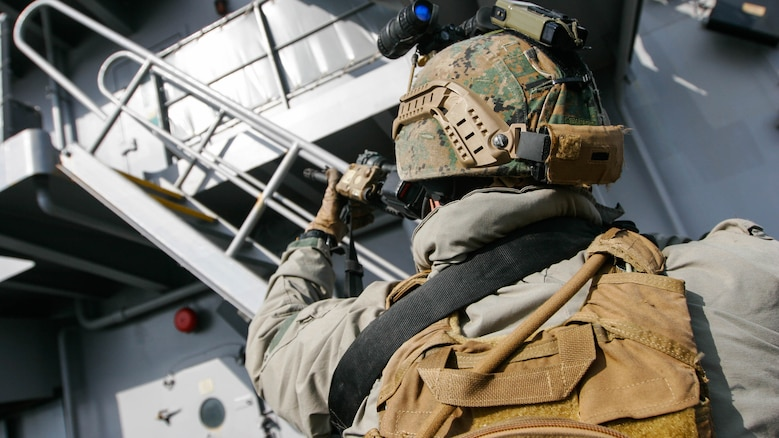 A reconnaissance Marine with Maritime Raid Force, 31st Marine Expeditionary Unit, works to ensure the upper decks of the USNS Rappahannock remain clear during a visit, board, search and seizure training exercise Feb. 17, 2016. The VBSS was conducted as part of the MEU's amphibious integration training with the Navy ships of the Bonhomme Richard Amphibious Ready Group. The Marines and sailors of the 31st MEU are currently on their spring deployment to the Asia-Pacific region.
