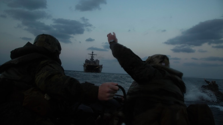 Marines with Bravo Company, Battalion Landing Team 1st Battalion, 5th Marines, 31st Marine Expeditionary Unit, send hand signals as they head back to the USS Germantown in Combat Rubber Raiding Craft, Feb. 17 , 2016, after conducting a successful boat raid the night before. The Marines conducted the boat raid as part of the 31st MEU's amphibious integration training with the Navy ships of the Bonhomme Richard Amphibious Ready Group. The Marines and sailors of the 31st MEU are currently deployed to the Asia-Pacific region.