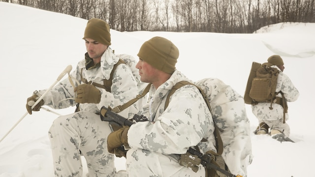 Cpl. Thomas Powers, a fire team leader with Black Sea Rotational Force, left, explains the next movement to Cpl. Greggory Williams, a machinegunner with BSRF, while conducting a routine patrol during the final exercise of cold-weather training aboard Porsangmoen, Norway, Feb. 16-20, 2016. Arctic training was conducted by U.K. Royal Marine Commando Mountain Leaders and hosted by the Norwegian military to improve the U.S. Marine Corps' capability to support their NATO Allies in extreme environments.