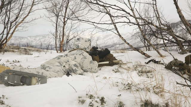 A Marine with Black Sea Rotational Force sights in on the enemy target while maintaining cover and concealment during the final exercise of cold-weather training aboard Porsangmoen, Norway, Feb. 16-20, 2016. Arctic training was conducted by U.K. Royal Marine Commando Mountain Leaders and hosted by the Norwegian military to improve the U.S. Marine Corps' capability to support their NATO Allies in extreme environments.