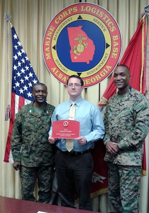 John Scholl (center), operations branch chief, Communications and Information System Division, Marine Corps Logistics Base Albany, accepts the 2015 Annual Safety Award from Col. James C. Carroll III (left), commanding officer, MCLB Albany, during the CO's Quarterly Safety Council Meeting, Feb. 3. Lt. Col. Nathaniel Robinson (right), executive officer, MCLB Albany, assisted with the presentation.