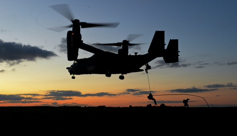 U.S. Air Force Air Commandos from the 352nd Special Operations Wing fast rope from a CV-22B Osprey currently assigned to the 7th Special Operations Squadron Feb. 11, 2016, during a routine training mission at RAF Sculthorpe in Norwich, England. The CV-22 Osprey is a tiltrotor aircraft that combines the vertical takeoff, hover and vertical landing qualities of a helicopter with the long-range, fuel efficiency and speed characteristics of a turboprop aircraft. Its mission is to conduct long-range infiltration, exfiltration and resupply missions for special operations forces. (U.S. Air Force photo by Staff Sgt. Micaiah Anthony/Released)